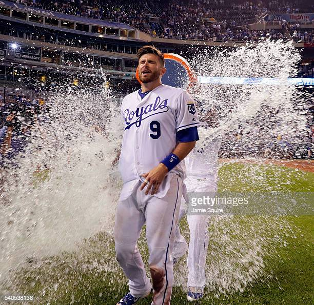 Salvador Perez of the Kansas City Royals douses catcher Drew Butera with blue gatorade after the Royals defeated the Cleveland Indians 94 to win the...