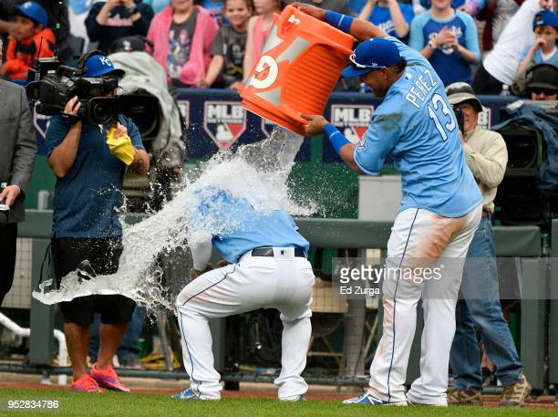 Salvador Perez of the Kansas City Royals douses Cheslor Cuthbert with water as they celebrate a 5-4 win over the Chicago White Sox at Kauffman...