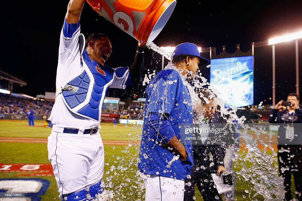 Salvador Perez #13 of the Kansas City Royals douses Edinson Volquez #36 of the Kansas City Royals after defeating the Toronto Blue Jays 5-0 in game one of the American League Championship Series at Kauffman Stadium on October 16, 2015 in Kansas City, Missouri.