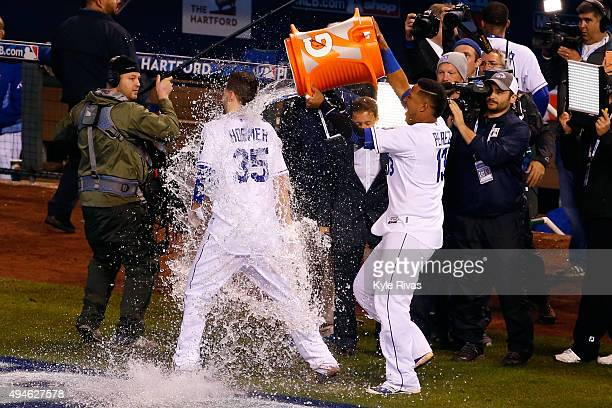 Salvador Perez of the Kansas City Royals douses Eric Hosmer of the Kansas City Royals after defeating the New York Mets 54 in Game One of the 2015...