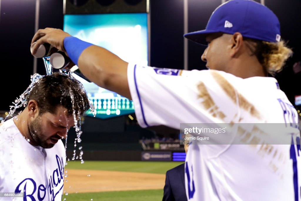 Salvador Perez #13 of the Kansas City Royals dumps cups of water over the head of game MVP Mike Moustakas #8 after the Royals defeated the New York Yankees to win the game 5-1 at Kauffman Stadium on May 18, 2017 in Kansas City, Missouri.