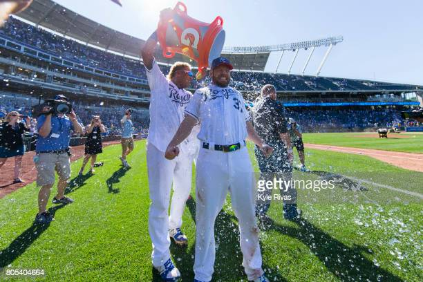 Salvador Perez of the Kansas City Royals dunked water on Brandon Moss of the Kansas City Royals after game one of a doubleheader against the...