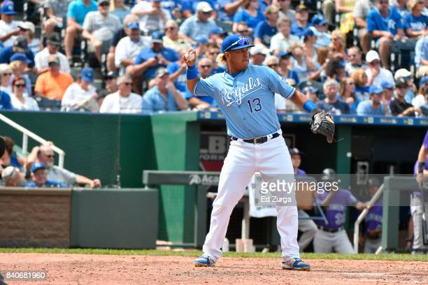 Salvador Perez of the Kansas City Royals helps warms up with a pitcher against the Colorado Rockies at Kauffman Stadium on August 24 2017 in Kansas...