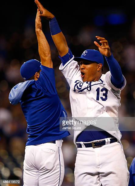Salvador Perez of the Kansas City Royals highfives pitcher Tim Collins after the Royals defeated the Detroit Tigers 157 to win the game against the...