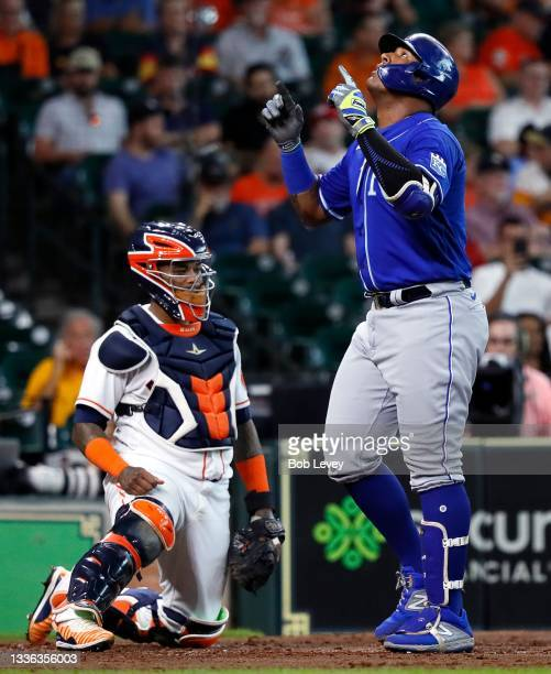 Salvador Perez of the Kansas City Royals hits a home run in the fourth inning as he crosses home plate in front of Martin Maldonado of the Houston...