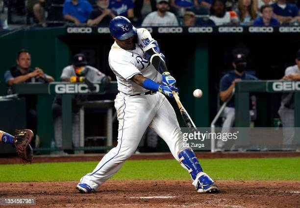 Salvador Perez of the Kansas City Royals hits a two-run single in the eighth inning against the Houston Astros at Kauffman Stadium on August 16, 2021...
