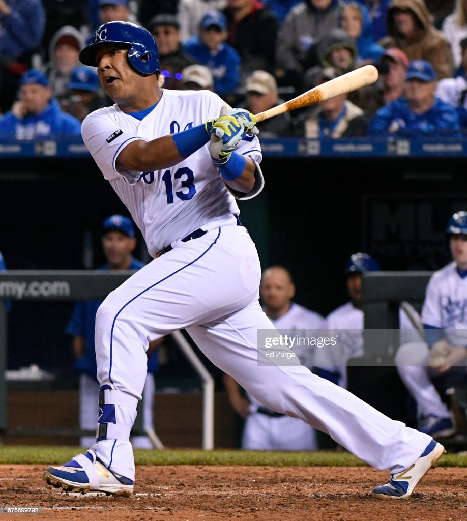 Salvador Perez #13 of the Kansas City Royals hits a two-run single in the fifth inning against the Chicago White Sox at Kauffman Stadium on May 1, 2017 in Kansas City, Missouri.