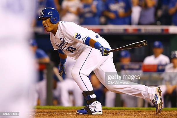Salvador Perez of the Kansas City Royals hits the game winning RBI single in the 12th inning against the Oakland Athletics during the American League...