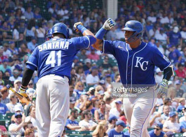 Salvador Perez of the Kansas City Royals is congratulated by Carlos Santana of the Kansas City Royals following his home run during the fourth inning...