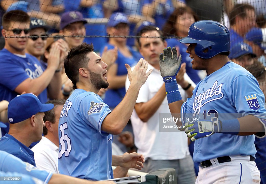 Salvador Perez #13 of the Kansas City Royals is congratulated by Eric Hosmer #35 after hitting a home run during the 7th inning of the game against the Seattle Mariners at Kauffman Stadium on July 9, 2016 in Kansas City, Missouri.