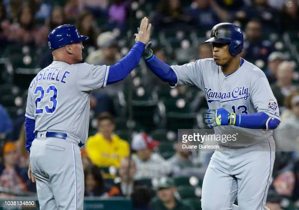 Salvador Perez of the Kansas City Royals is congratulated by third base coach Mike Jirschele of the Kansas City Royals after hitting a solo home run...
