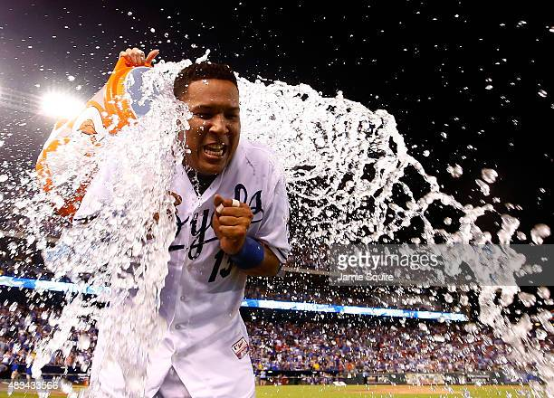 Salvador Perez of the Kansas City Royals is doused with water after the Royals defeated the Chicago White Sox 7-6 to win the game at Kauffman Stadium...