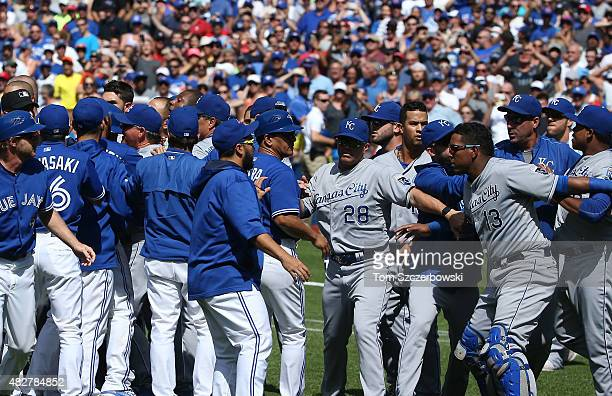 Salvador Perez of the Kansas City Royals is held back by teammates as both benches clear in the eighth inning during MLB game action against the...