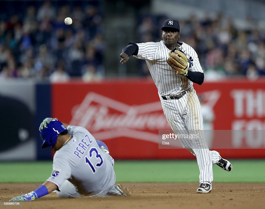Salvador Perez #13 of the Kansas City Royals is out at second as Didi Gregorius #18 of the New York Yankees sends the ball to first in the fifth inning at Yankee Stadium on May 11, 2016 in the Bronx borough of New York City.