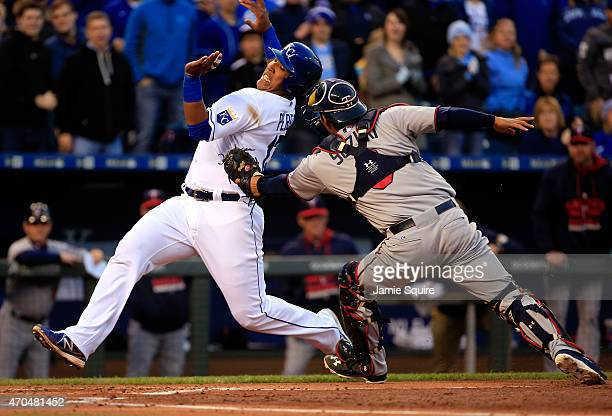 Salvador Perez of the Kansas City Royals is tagged out at home plate by catcher Kurt Suzuki of the Minnesota Twins while trying to score during the...