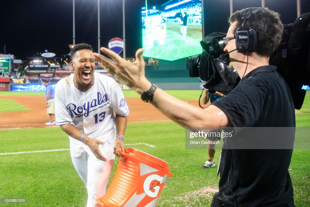 Salvador Perez #13 of the Kansas City Royals laughs and apologizes to a camera operator after accidentally getting Gatorade on him after the game against the Chicago Cubs at Kauffman Stadium on August 8, 2018 in Kansas City, Missouri.