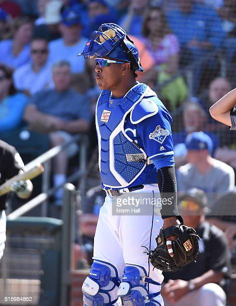 Salvador Perez of the Kansas City Royals looks out to the pitchers mound while standing behind home plate against the Chicago White Sox at Surprise...
