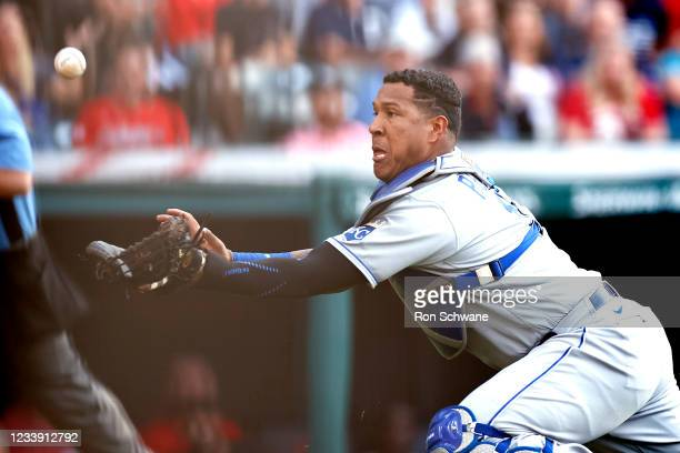 Salvador Perez of the Kansas City Royals makes a diving catch on a foul ball to get out Bradley Zimmer of the Cleveland Indians during the third...
