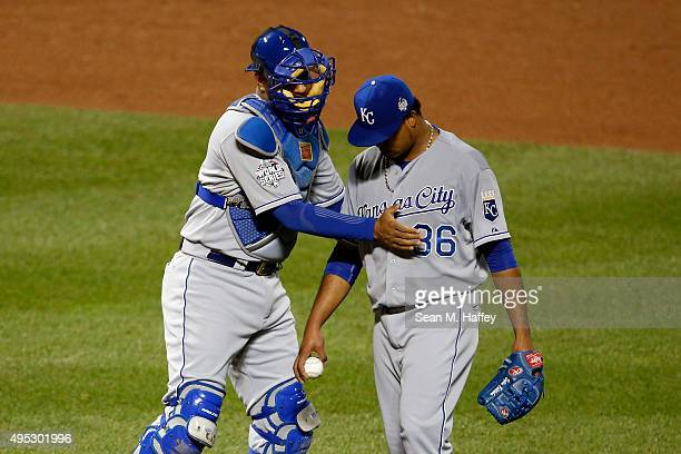 Salvador Perez of the Kansas City Royals meets with Edinson Volquez of the Kansas City Royals on the pitcher's mound in the sixth inning against the...