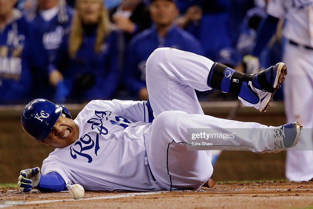 Salvador Perez #13 of the Kansas City Royals reacts after being hit by a pitch in the second inning by the San Francisco Giants during Game Seven of the 2014 World Series at Kauffman Stadium on October 29, 2014 in Kansas City, Missouri.