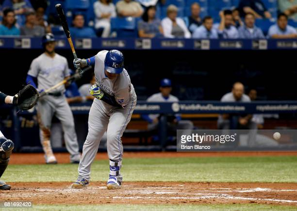 Salvador Perez of the Kansas City Royals reacts after being hit by a pitch from Chris Archer of the Tampa Bay Rays during the seventh inning of a...