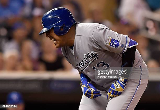Salvador Perez of the Kansas City Royals reacts to being hit by a pitch in an at bat against the Minnesota Twins during the seventh inning of the...