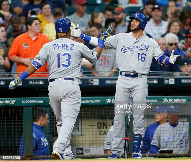 Salvador Perez of the Kansas City Royals receives congratulations Paulo Orlando after hitting a home run in the second inning against the Houston...
