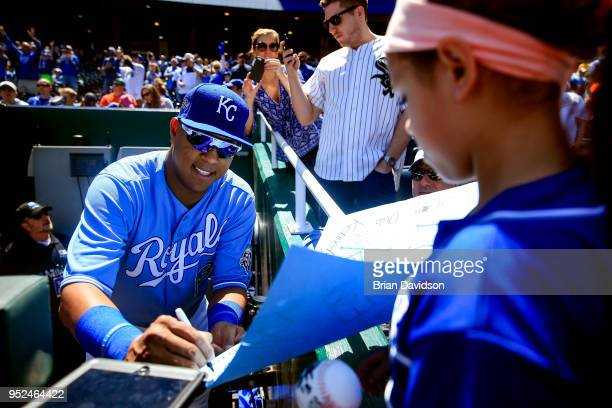 Salvador Perez of the Kansas City Royals signs an autograph before game one of a doubleheader against the Chicago White Sox at Kauffman Stadium on...