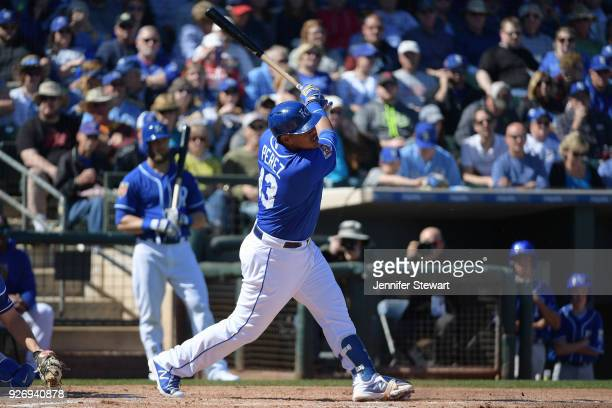 Salvador Perez of the Kansas City Royals swings at a pitch in the spring training game against the Los Angeles Dodgers at Surprise Stadium on...