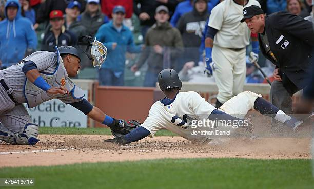 Salvador Perez of the Kansas City Royals tages out Dexter Fowler of the Chicago Cubs in the 11th inning at Wrigley Field on May 31 2015 in Chicago...