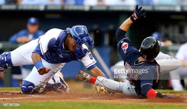 Salvador Perez of the Kansas City Royals tags out Asdrubal Cabrera of the Cleveland Indians as he tries to score in the first inning at Kauffman...