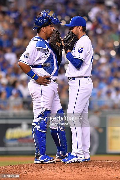 Salvador Perez of the Kansas City Royals talks with pitcher Joakim Soria of the Kansas City Royals after he was called in to the game in the eighth...