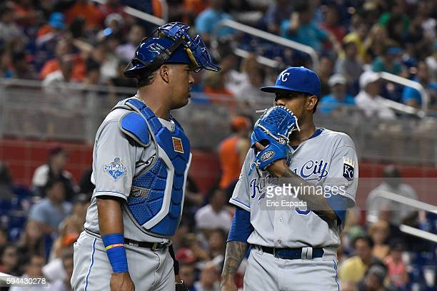 Salvador Perez of the Kansas City Royals talks with pitcher Yordano Ventura during the 3rd inning against the Miami Marlins at Marlins Park on August...