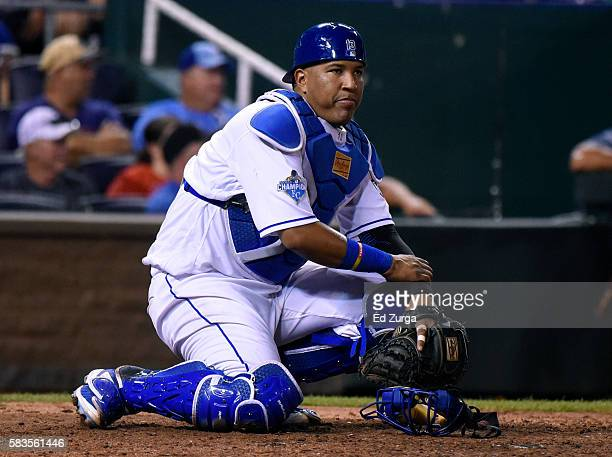 Salvador Perez of the Kansas City Royals watches Daniel Nava of the Los Angeles Angels of Anaheim walk to first after Nava was hit by a pitch in the...