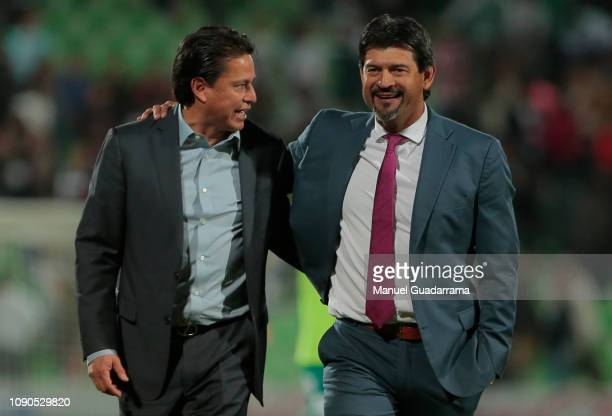 Salvador Reyes head coach of Santos hugs Jose Cardozo of Chivas during the 4th round match between Santos Laguna and Chivas as part of the Torneo...