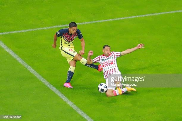 Salvador Reyes of America struggles for the ball against Julio González of Necaxa during the 2nd round match between America and Necaxa as part of...