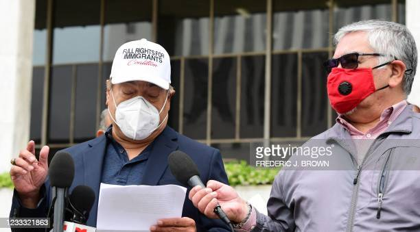 Salvador Sanabria, who was forced into exile in 1980 by the military regime governing El Salvador, holds a microphone for John Fernandez from the...