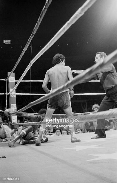 Salvador Sanchez moves toward referee Tony Perez after knocking down Azumah Nelson during the fight at Madison Square Garden on July 21 1982 in New...