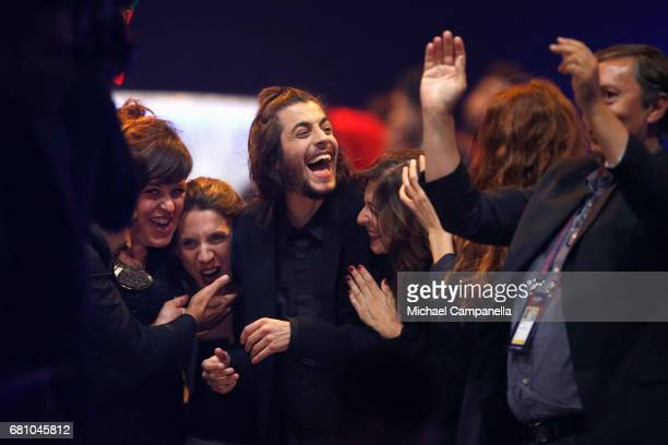 Salvador Sobral representing Portugal reacts to making it to the Grand Final during the first semi final of the 62nd Eurovision Song Contest at...