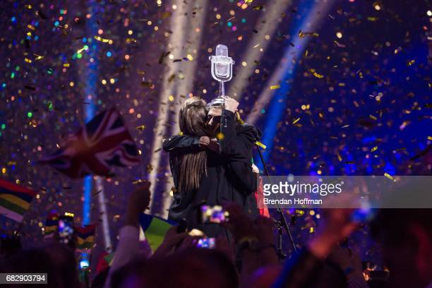 Salvador Sobral the contestant from Portugal holds the trophy and hugs his sister Luisa Sobral who wrote his winning song after being announced as...