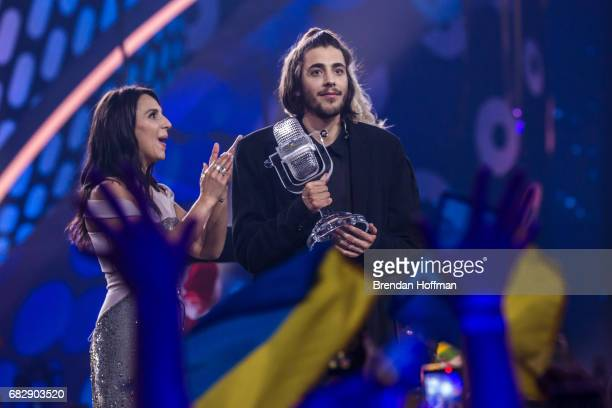 Salvador Sobral the contestant from Portugal receives the trophy after being announced as the winner from last year's winner Jamala at the Eurovision...