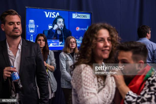 Salvador Sobral the winning contestant from Portugal is seen on a television screen during the winner's press conference at the Eurovision Grand...
