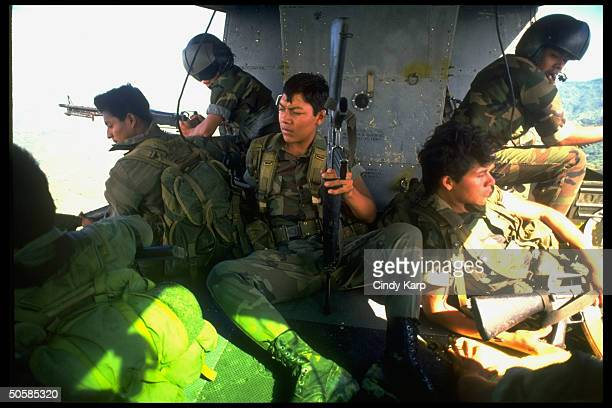 Salvadoran Air Force helicopter gunners during rescue mission to evacuate wounded ground troops coming under guerrilla fire in area of Guazapa volcano