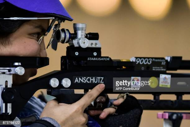 Salvadoran Ana Ramirez competes to win gold medal in the Women's 10m Air Rifle Shooting Final at the XVIII Bolivarian Games in Cali Colombia on...