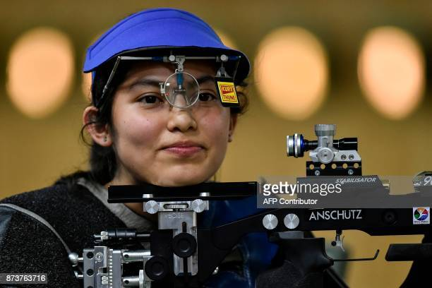 Salvadoran Ana Ramirez smiles after winning gold medal in the Women's 10m Air Rifle Shooting Final at the XVIII Bolivarian Games in Cali Colombia on...