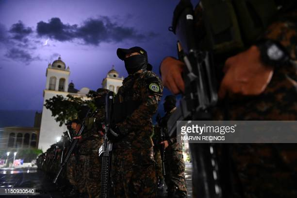 Salvadoran Armed Forces soldiers line up in the historic centre of San Salvador on June 20 during the launch of a new security plan pushed by...