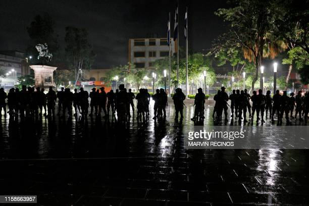 Salvadoran Armed Forces soldiers stand in formation in downtown San Salvador on June 20 during the launch of a new security plan pushed by Salvadoran...