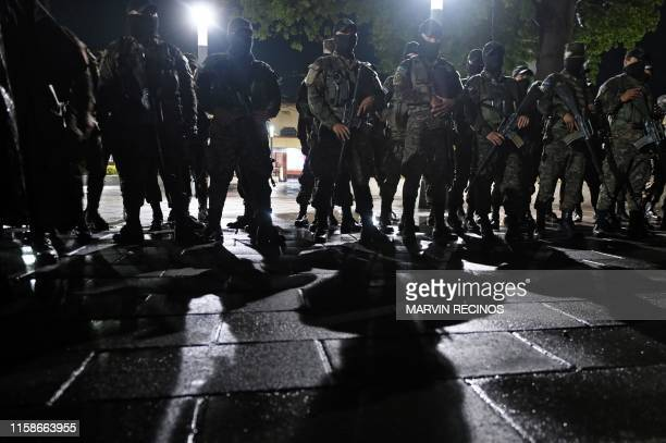 Salvadoran Armed Forces stand in formation in downtown San Salvador on June 20 during the launch of a new security plan pushed by Salvadoran...