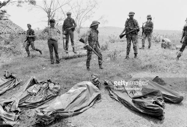 Salvadoran army soldiers gather body bags of 57 dead soldiers killed by guerrillas from the Farabundo Martí National Liberation Front in Tejutepeque,...