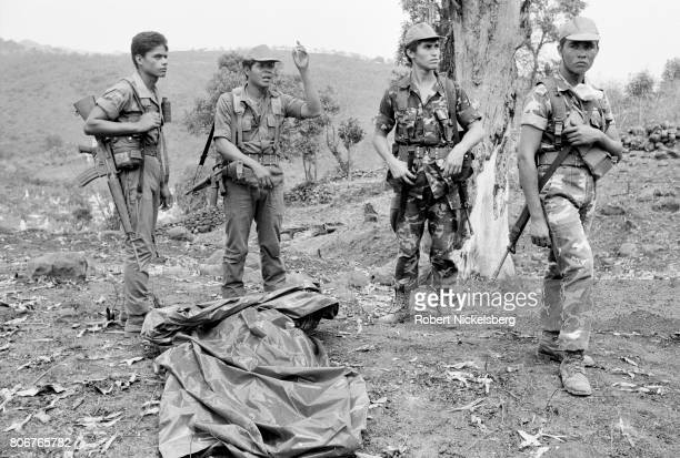 Salvadoran army soldiers gather body bags of 57 dead soldiers killed by guerrillas of the Farabundo Martí National Liberation Front in Tejutepeque El...